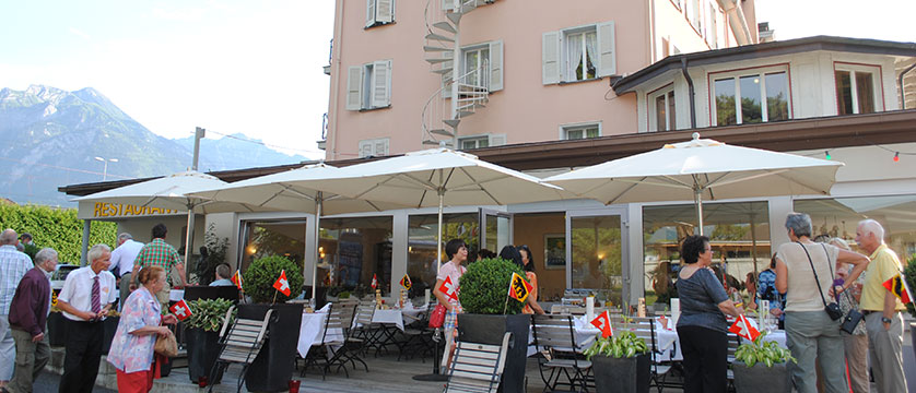 Hotel Du Lac, Interlaken, Bernese Oberland, Switzerland - exterior with guests outside the restaurant.jpg